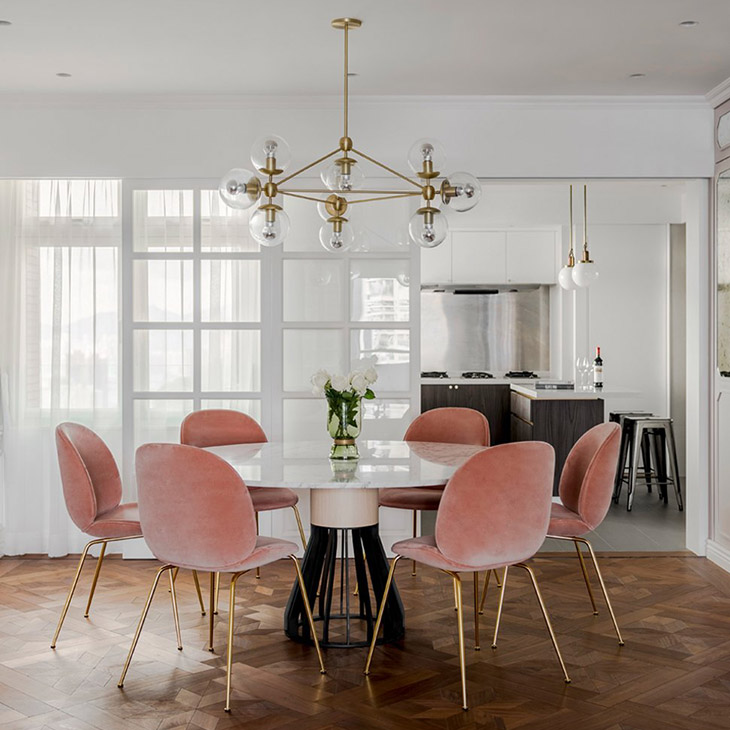 modern dining room featuring a roll and hill modo chandelier