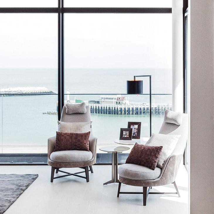 modern living room featuring two flexform guscioalto armchairs