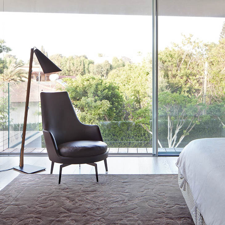 modern bedroom featuring a flexform guscioalto armchair