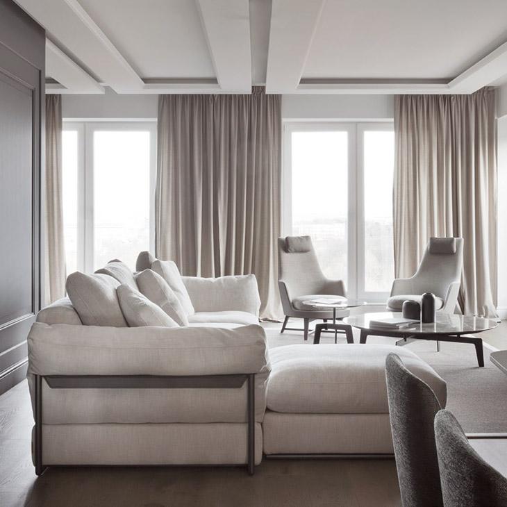 modern living room featuring a two flexform guscioalto armchairs