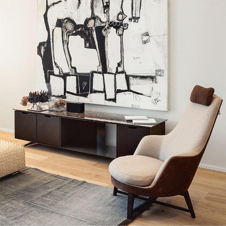 modern living room featuring a flexform guscioalto armchair