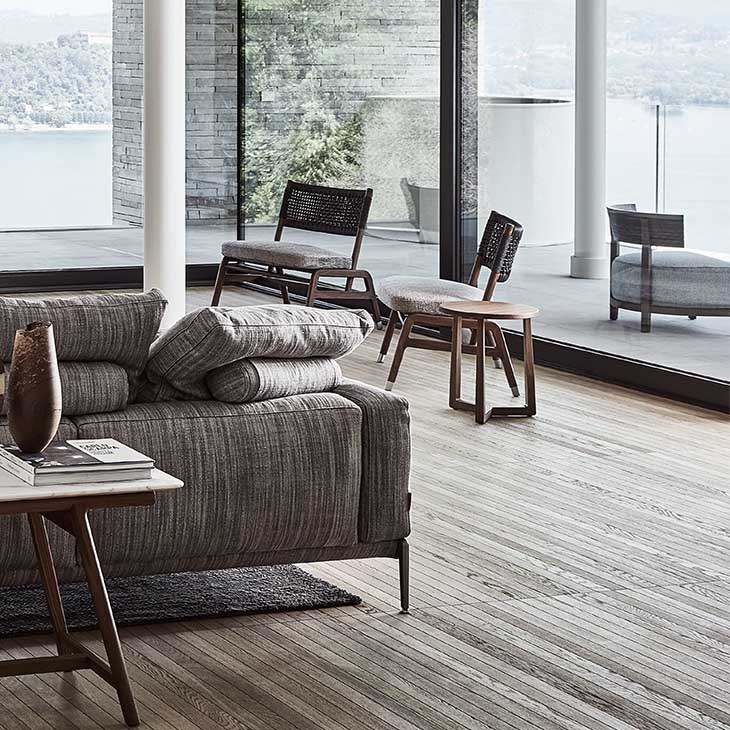 modern living room featuring two flexform ortigia armchairs without armrests