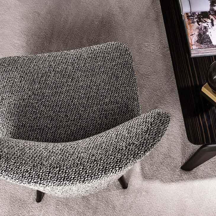 modern sitting area featuring minotti aston armchair