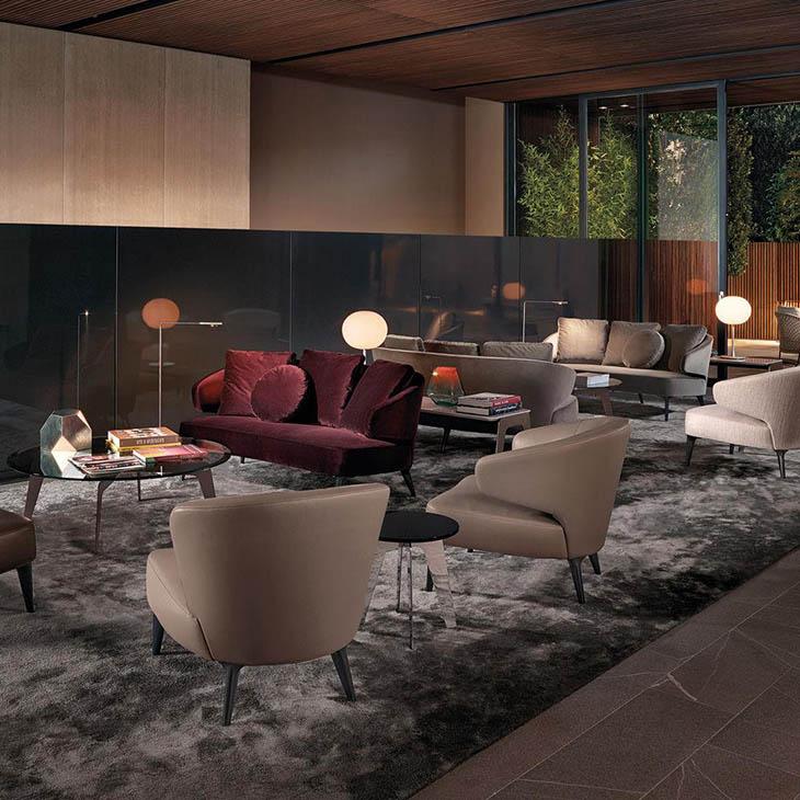 modern lobby featuring minotti aston sofas and armchairs