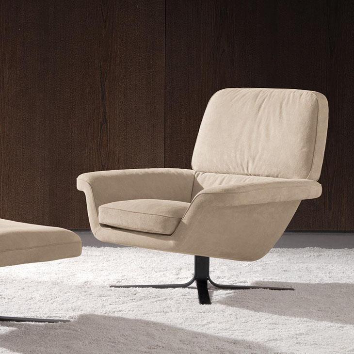modern living room featuring a minotti blake-soft armchair