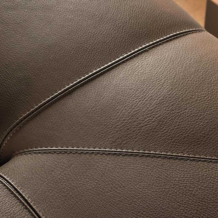 close up of the leather and stitching on a minotti freeman duvet sofa