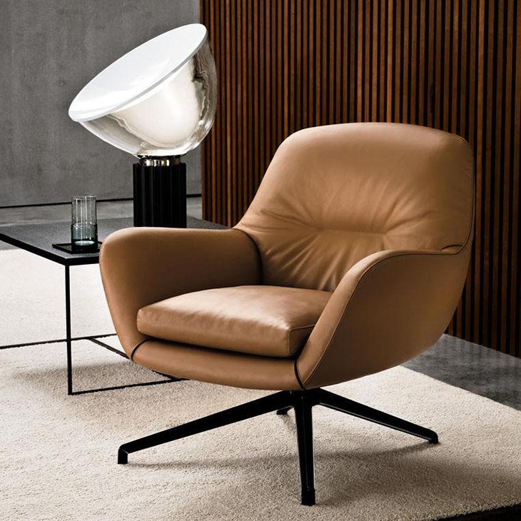 modern living room featuring minotti jensen armchair