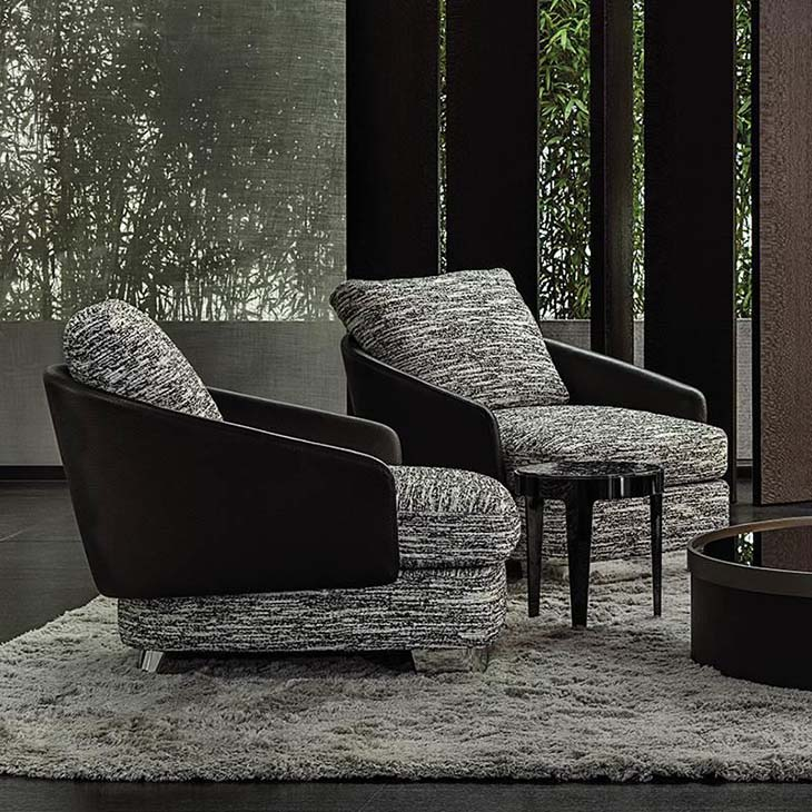 modern living room featuring two minotti lawson armchairs
