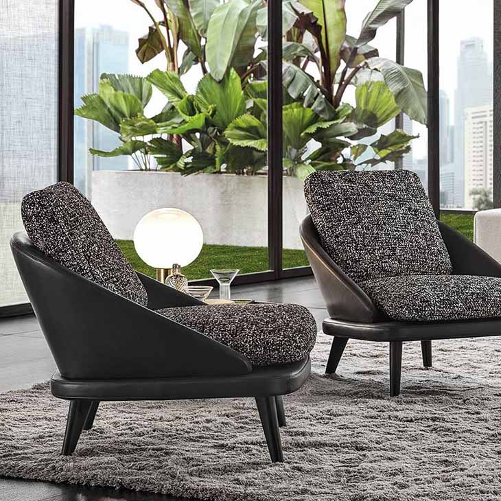 modern living room featuring two minotti lawson armchairs with wood legs