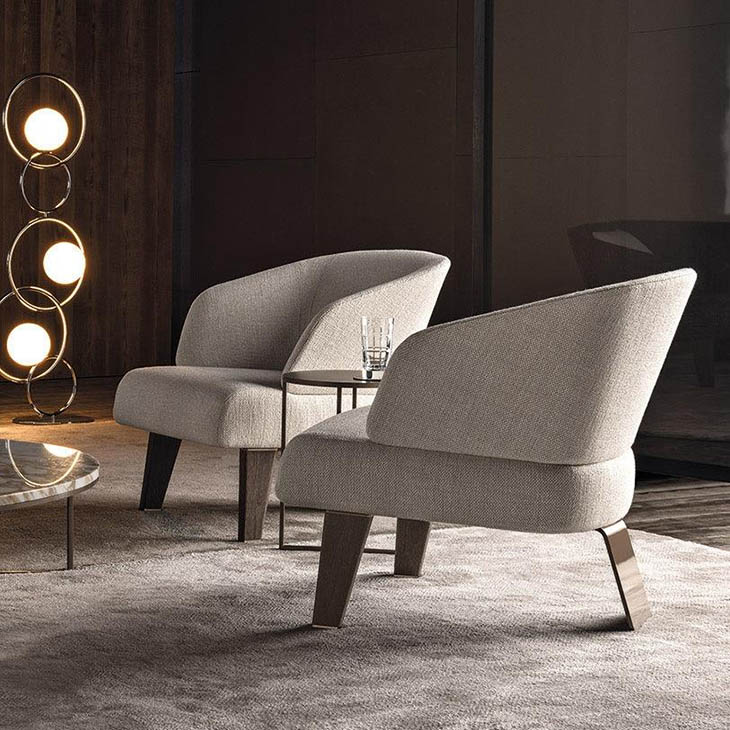 modern living room featuring minotti reeves small armchair