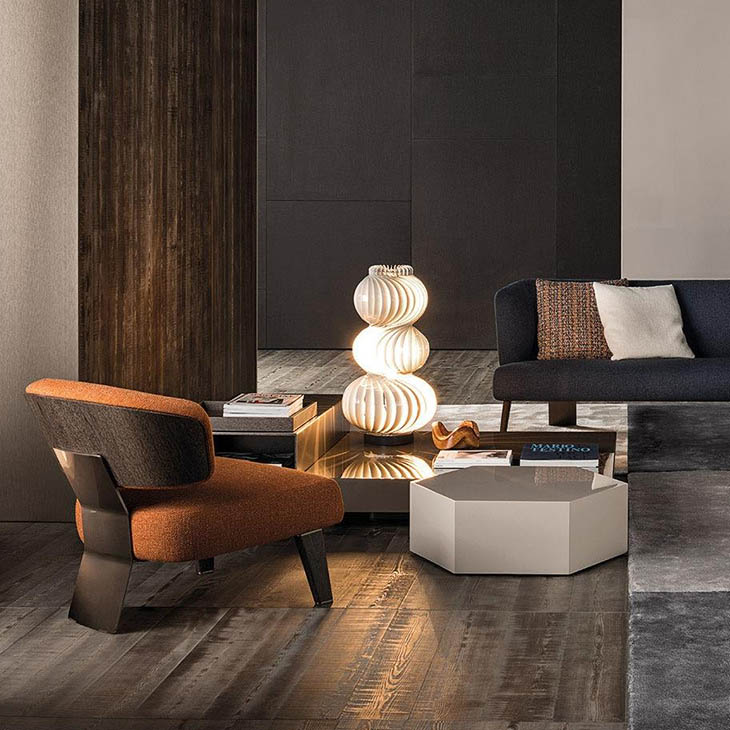 modern living room featuring minotti reeves wood armchair