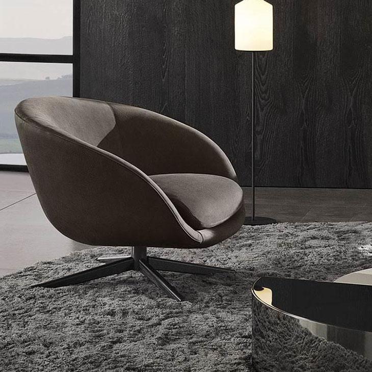 modern living room featuring minotti russell armchair