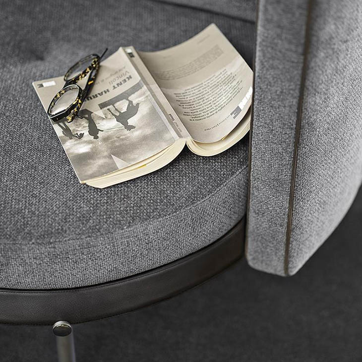 close up of piping on a minotti torii armchair
