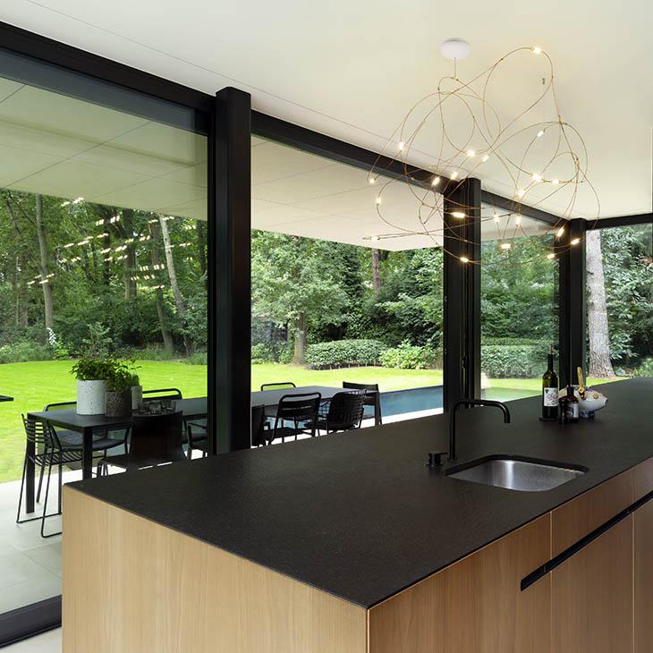 modern kitchen featuring moooi flock of light pendant