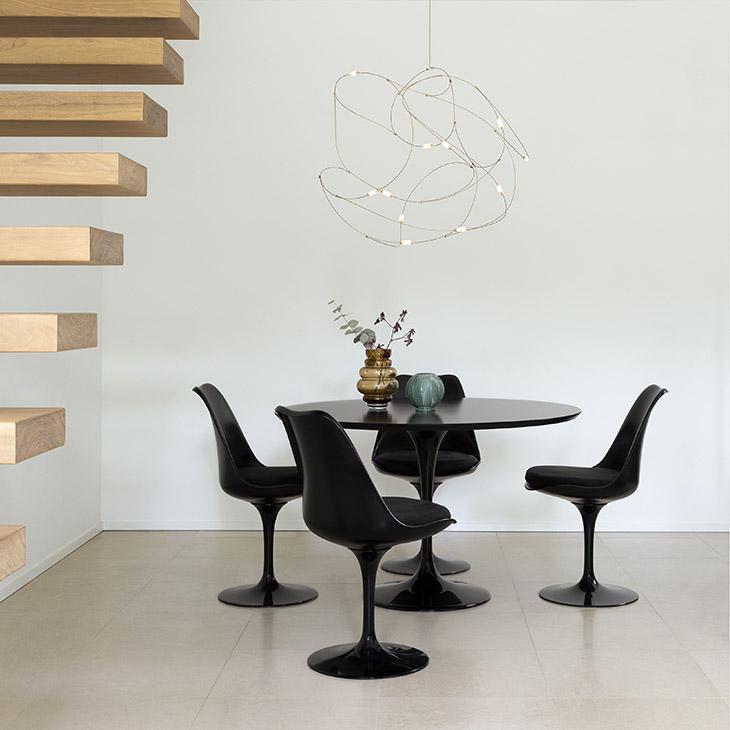 modern dining room featuring moooi flock of light pendant