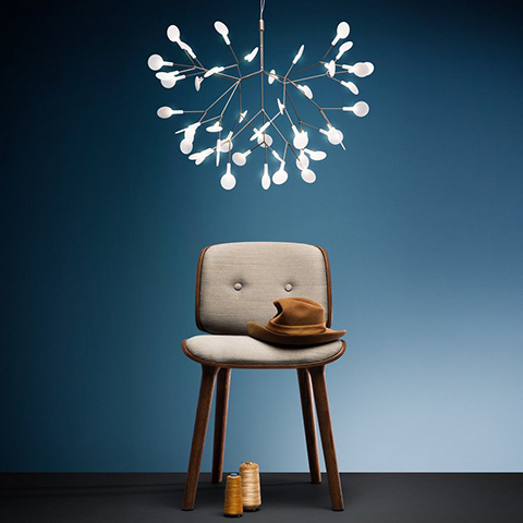 moooi heracleum II suspended pendant light hanging above a stool