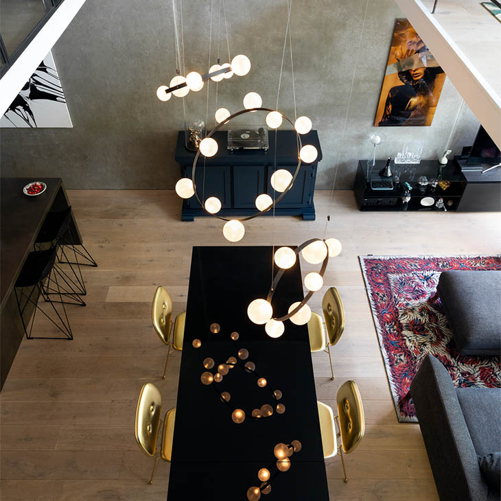 modern dining room featuring a cluster of three moooi hubble bubble pendant lights