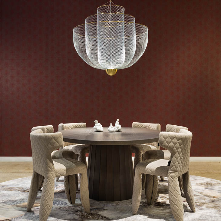 modern dining room featuring moooi meshmatics pendant light