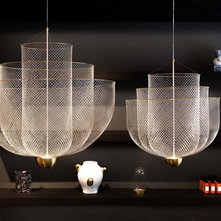 two moooi meshmatics pendant lights in a retail setting