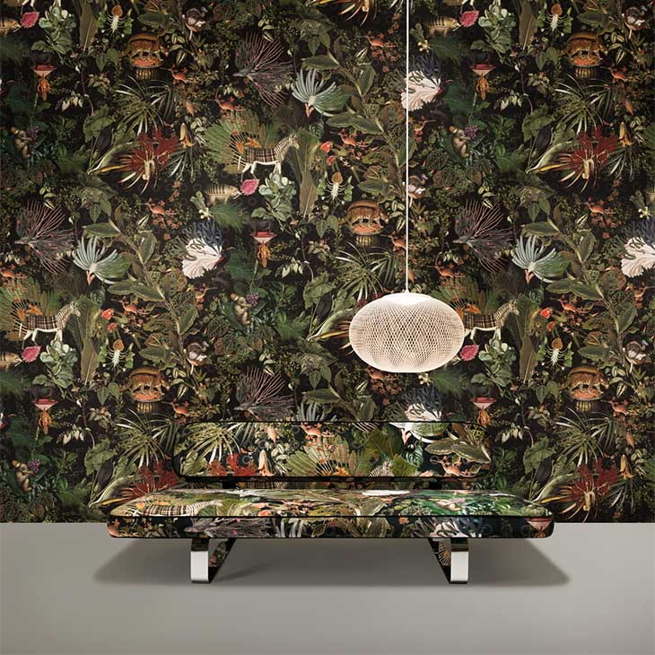 dramatically wallpapered room featuring a moooi nr2 pendant light