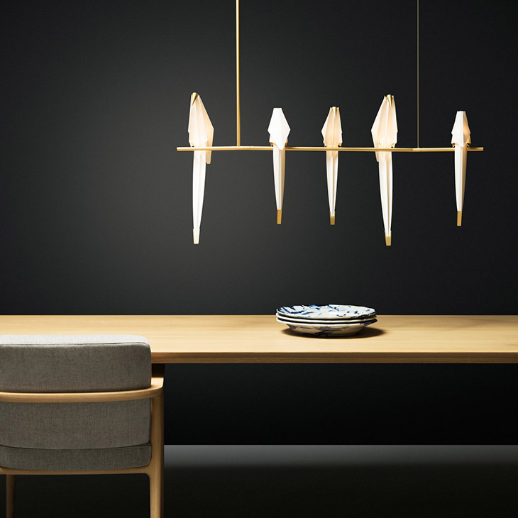 modern dining room featuring moooi perch light branch pendant large