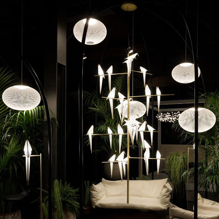 modern living room featuring moooi perch light tree pendant and several moooi nr2 pendants