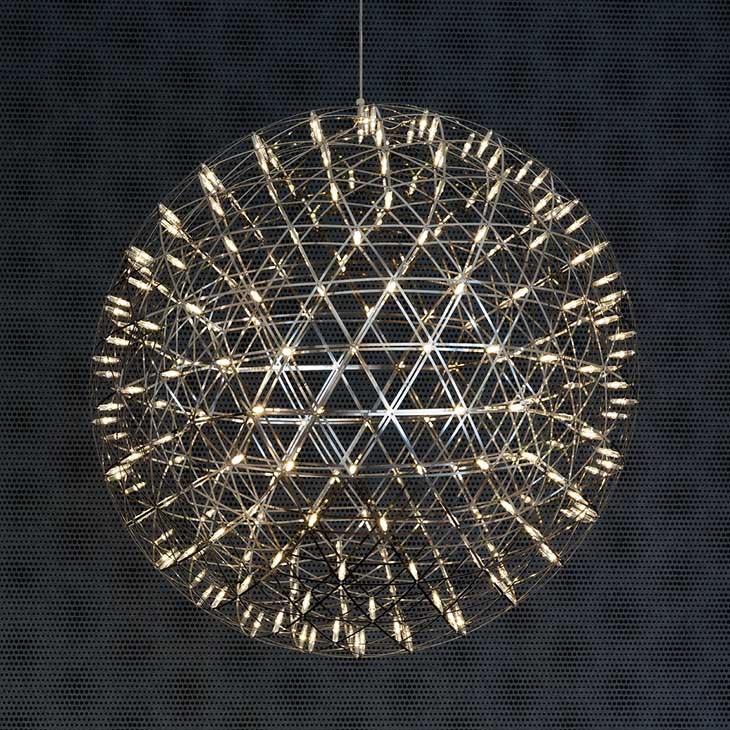 moooi raimond pendant light glowing in a dark room