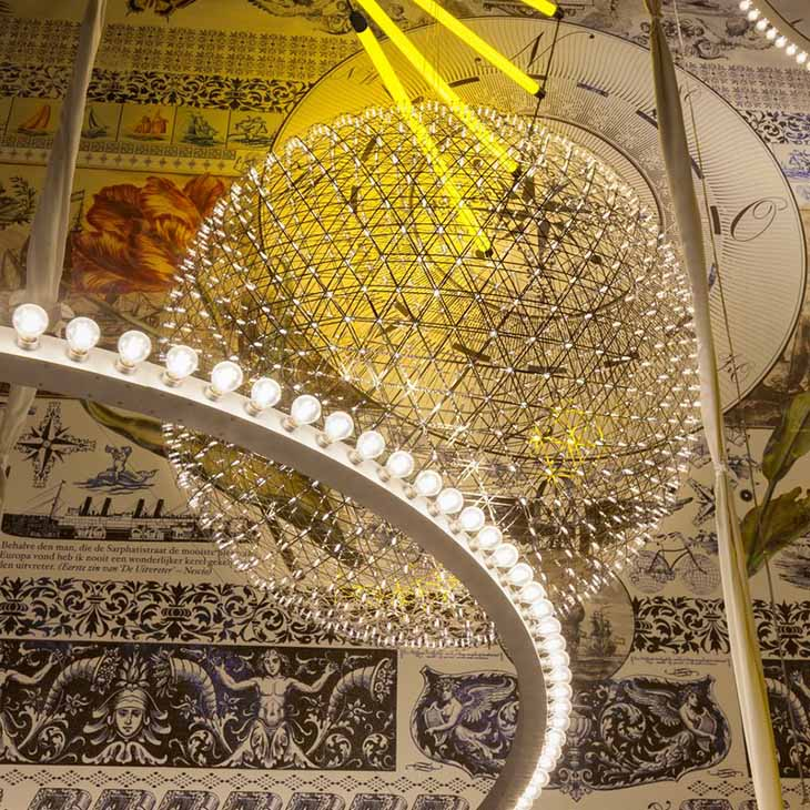 moooi raimond r127 pendant light clustered with other moooi pendants in a decorative room