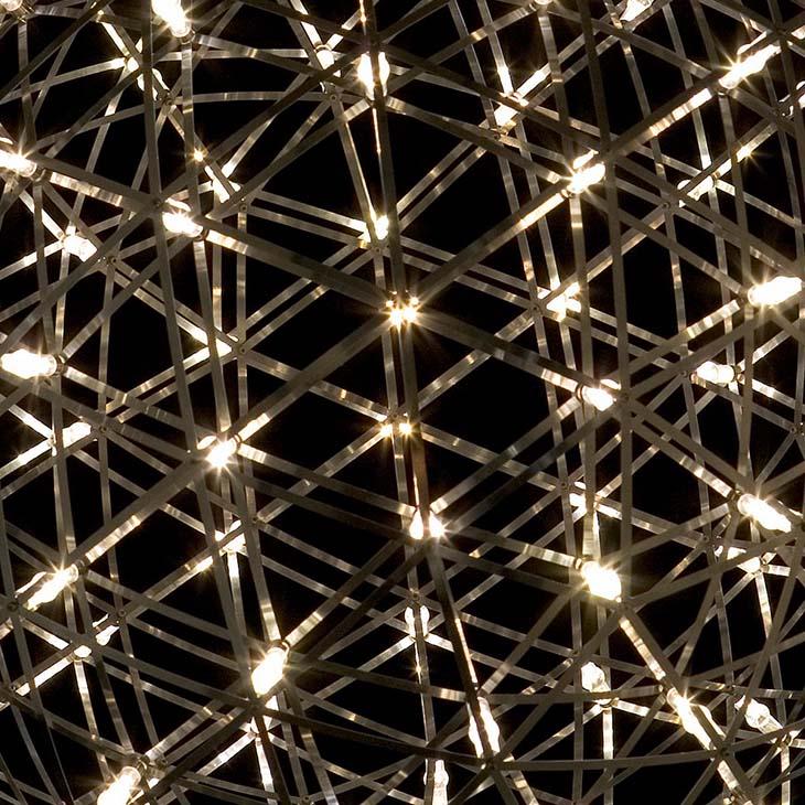 moooi raimond r127 pendant light glowing in a dark room