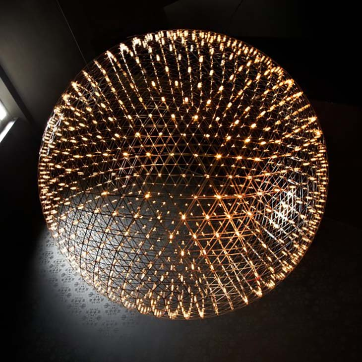 moooi raimond r199 pendant light glowing in a dark room