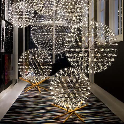 moooi raimond tensegrity floor lamps and pendants in a hallway