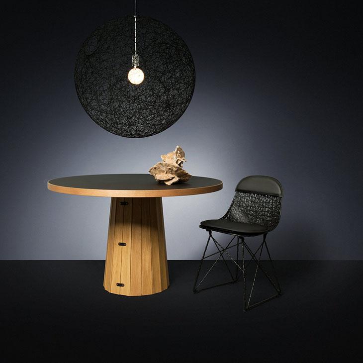 modern dining room featuring a black moooi random light II pendant