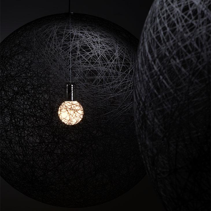 two moooi random light II pendants glowing in a dark room