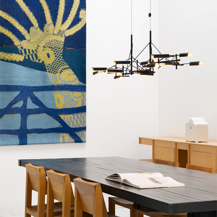 modern dining room featuring moooi tinkering pendant light