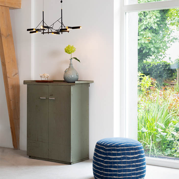 interior space featuring moooi tinkering pendant light above a cabinet