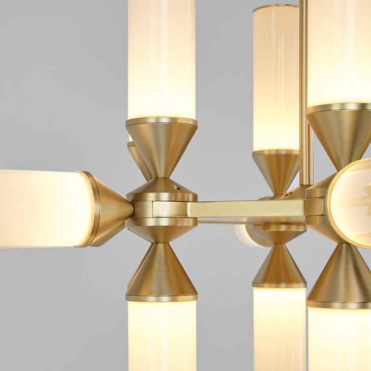 close up of a roll & hill castle pendant in brushed brass with cream glass