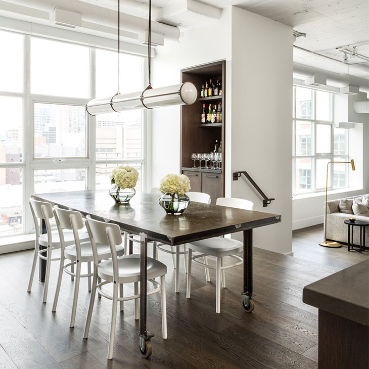 modern dining room featuring a roll & hill endless pendant 3 units in black