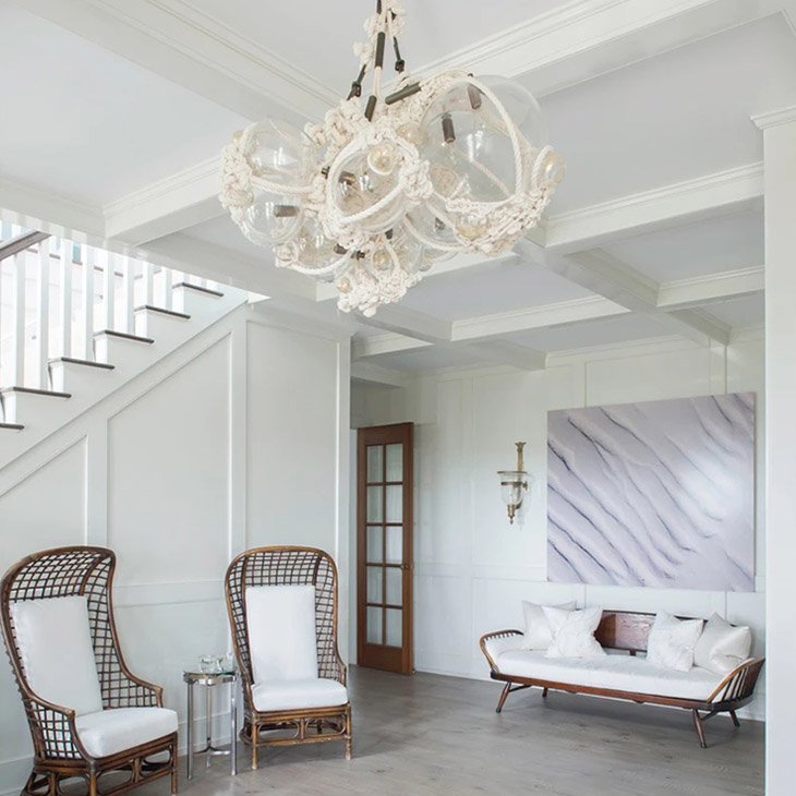 coastal home featuring roll & hill knotty bubbles chandelier