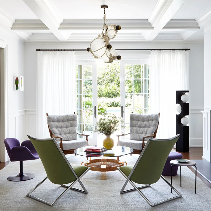 artsy sitting room featuring roll & hill knotty bubbles pendant light