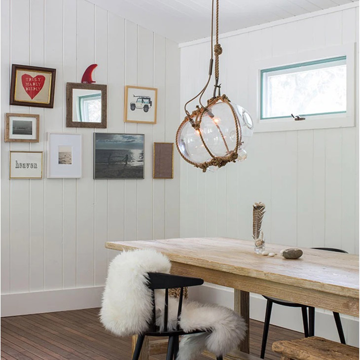 coastal dining room featuring roll & hill knotty bubbles pendant light