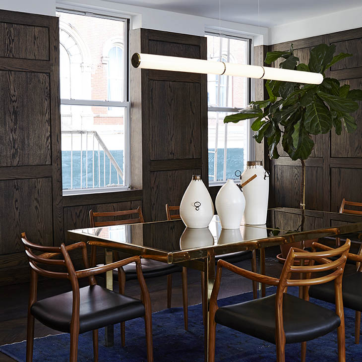 modern dining room featuring roll & hill mini endless pendant