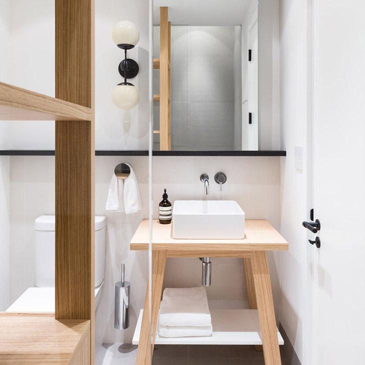 modern bathroom featuring a roll and hill modo sconce 2 globes