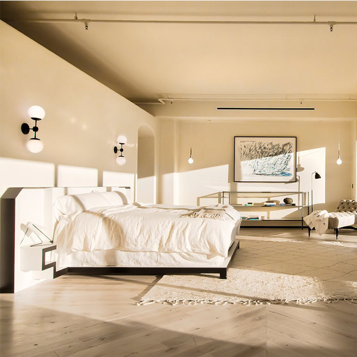 bedroom featuring a roll and hill modo sconce 2 globes