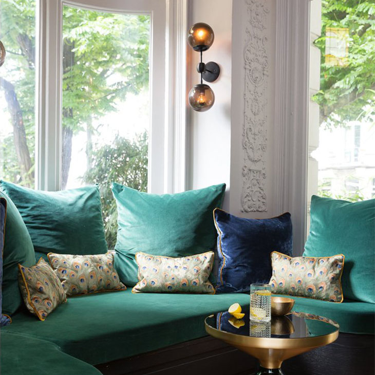 living room featuring a roll and hill modo sconce 2 globes