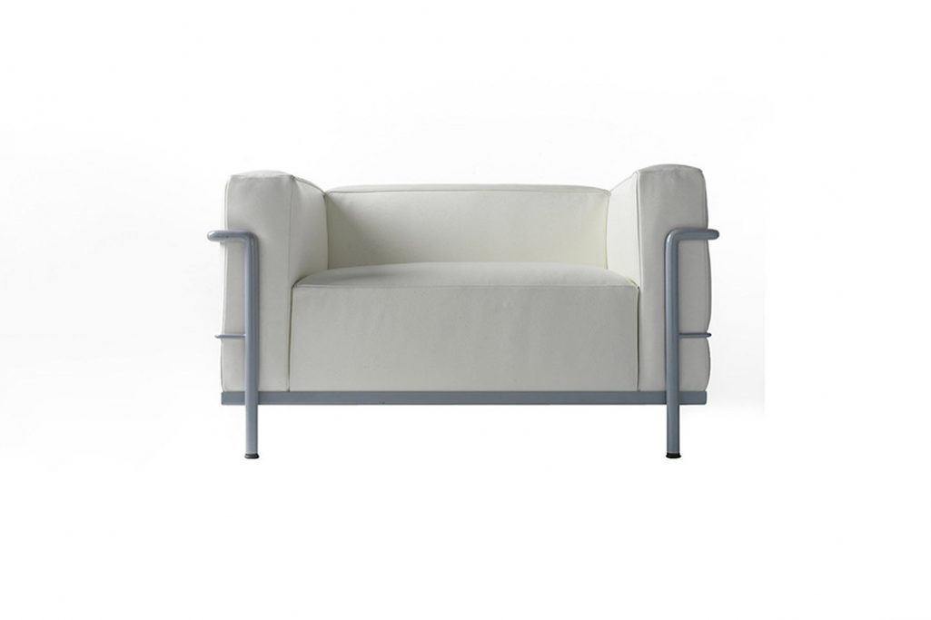 cassina lc3 armchair with light blue enamel base finish on a white background