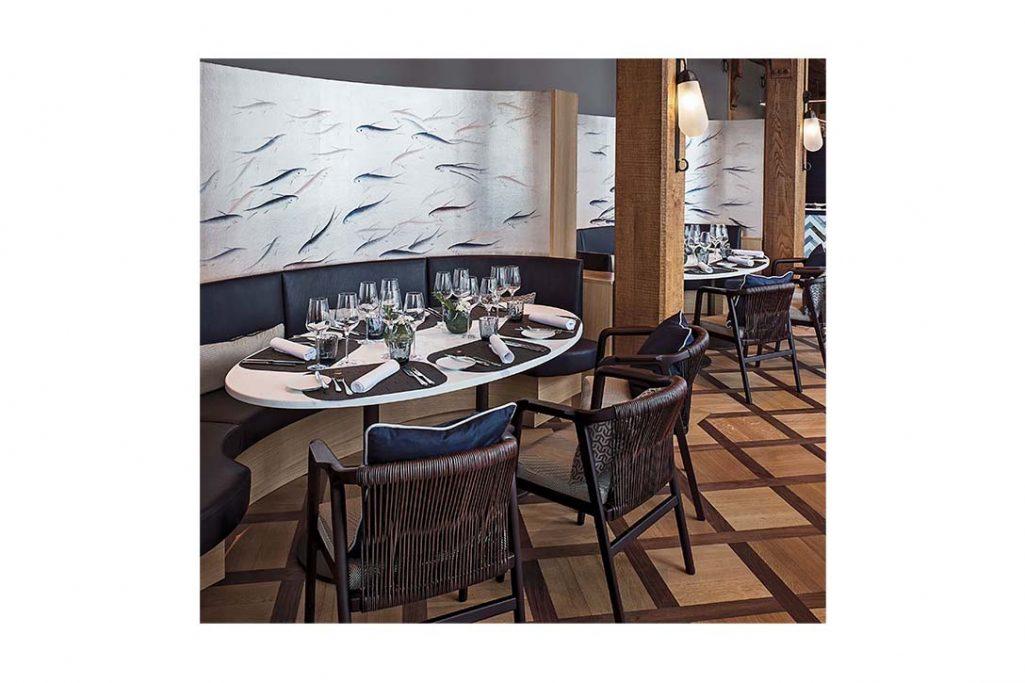 modern restaurant featuring flexform crono dining chair