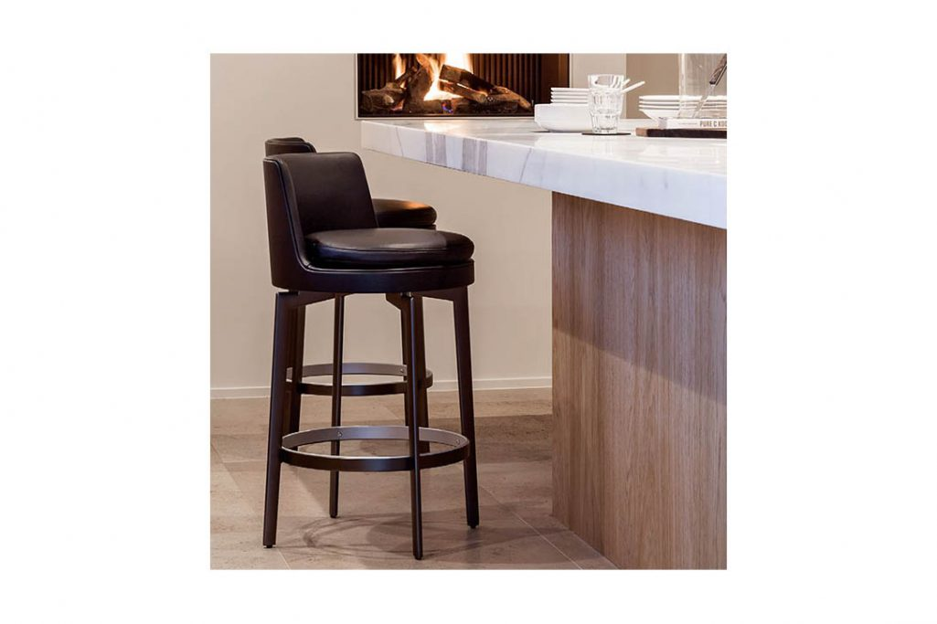 modern kitchen featuring two flexform feel good stools