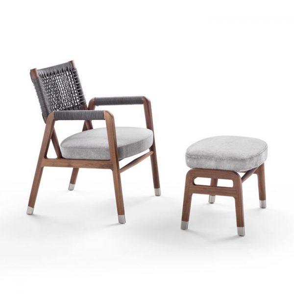flexform ortigia armchair and ottoman on a white background