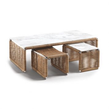 flexform tindari coffee table, ottoman, and side table on a white background