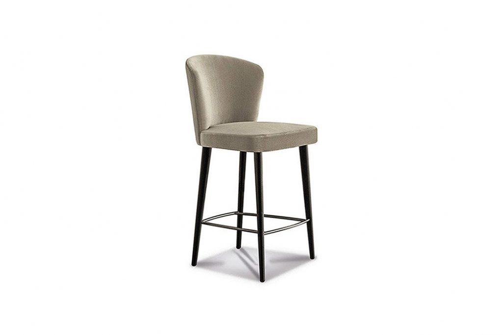 minotti aston counter stool on a white background